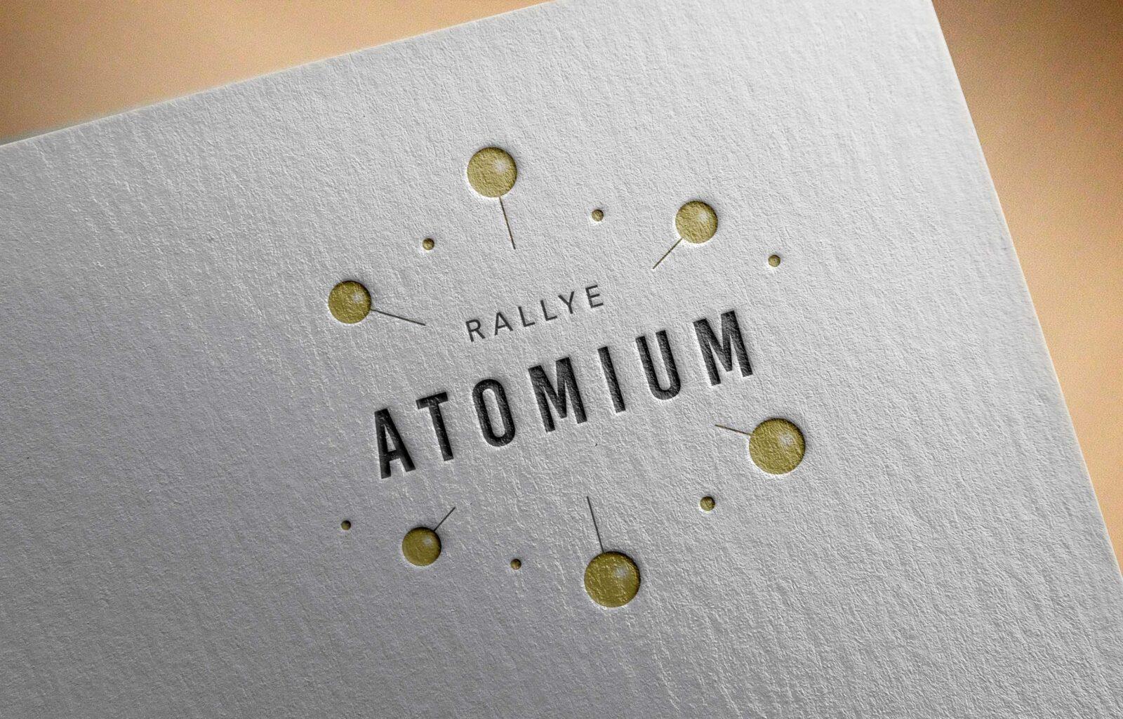 Logo atomium réalisation graphique de par C Com'Créa